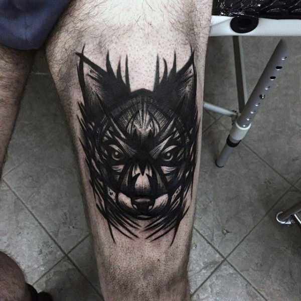 Cool designed black and white mystical wolf tattoo on thigh