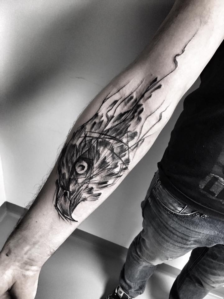 Cool designed by Inez Janiak forearm tattoo of eagle head