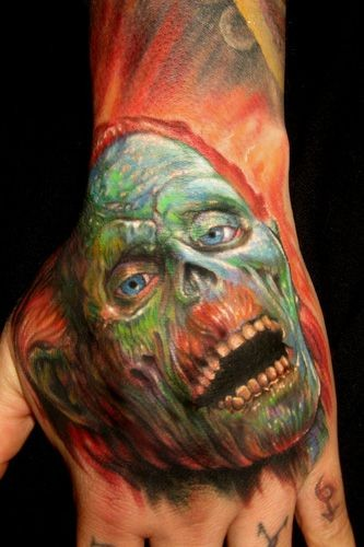 Cool detailed and painted colored zombie face tattoo on hand