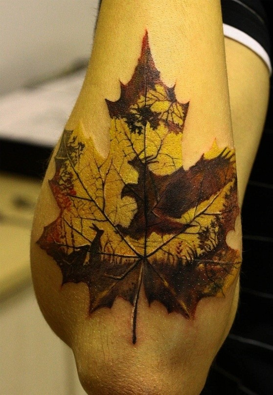 Cool eagle hunts hares in print maple leaf forearm tattoo