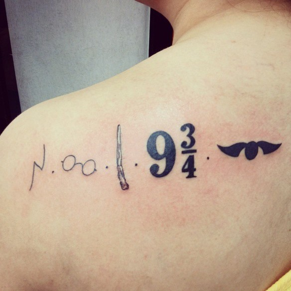 Cool Harry Potter themed on shoulder tattoo stylized with various symbols