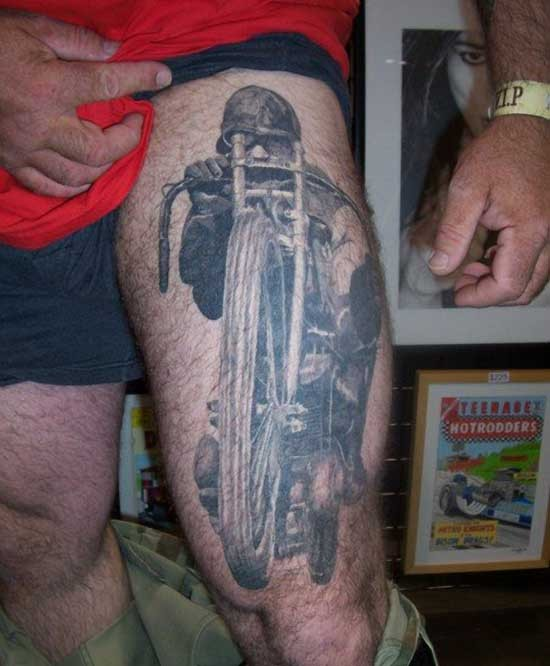 Cool idea of motorcycle tattoo on thigh