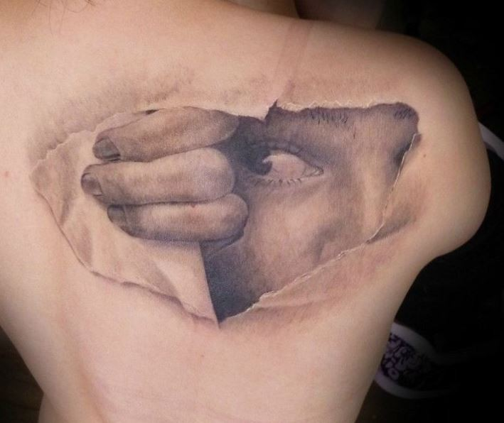 Cool idea of skin rip tattoo on upper back for Skin gallery tattoo