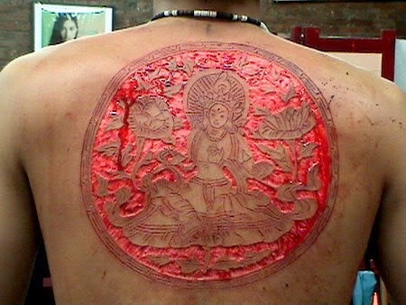 Cool idea of skin scarification on back for men