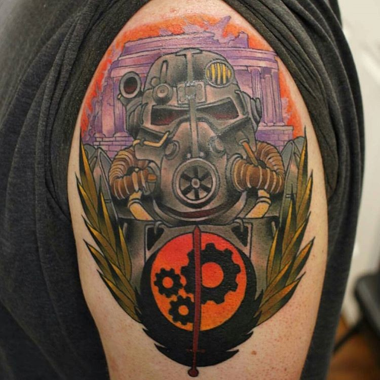 Cool illustrative style colored Fallout armor tattoo on shoulder