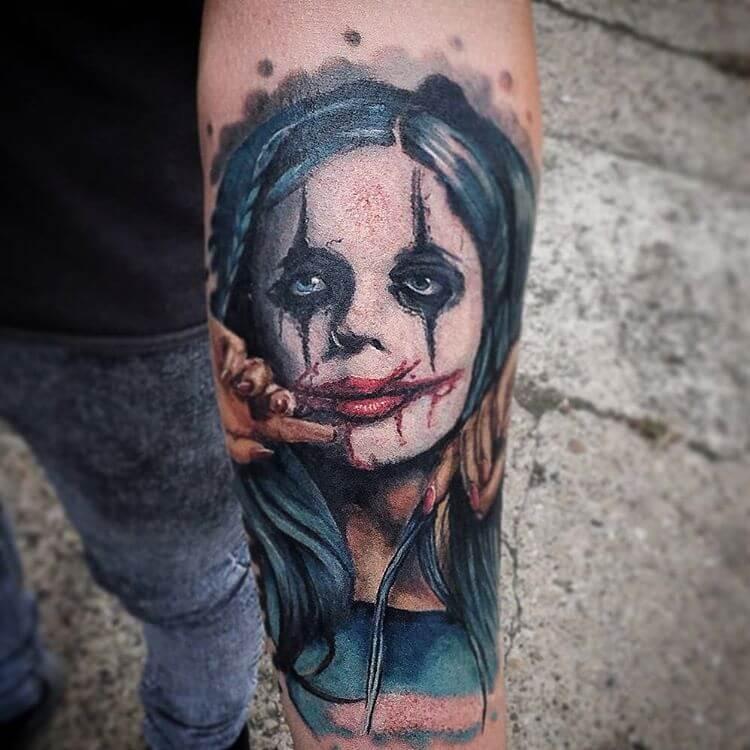 Cool Joker like colored portrait style forearm tattoo of evil woman