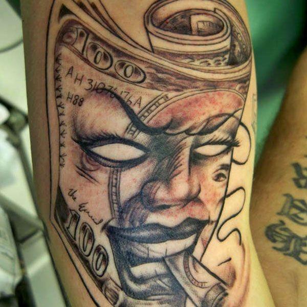 Cool Joker like smoking mask shaped money bill tattoo on arm