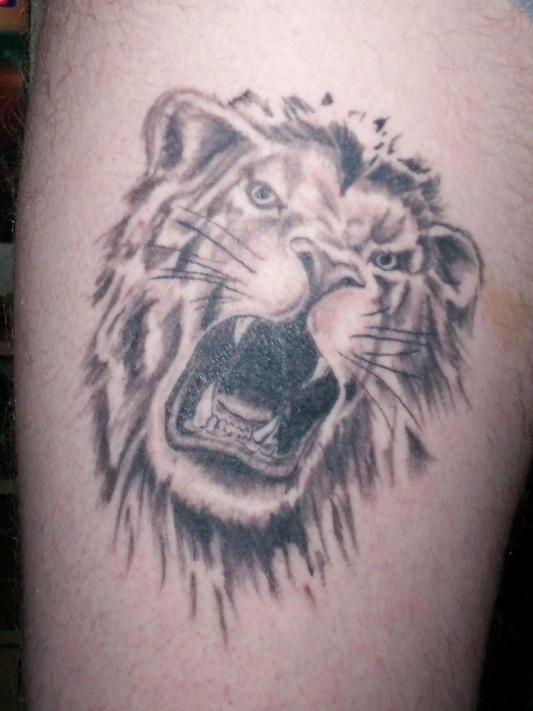 Cool lion face tattoo design idea