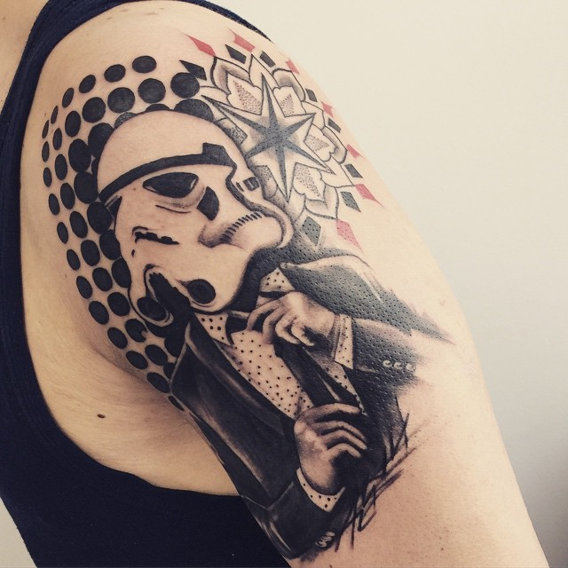 Cool looking black and white shoulder tattoo of Storm trooper in suit