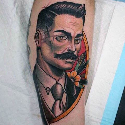 Cool looking colored forearm tattoo of vintage man portrait