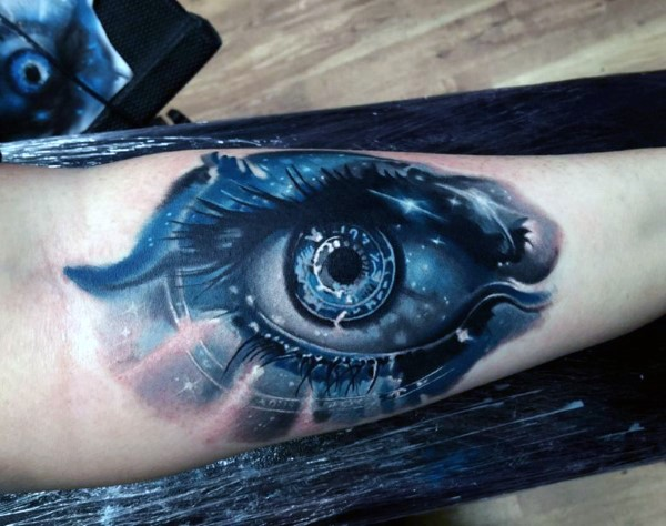 Cool looking colored forearm tattoo of mystical eye with stars