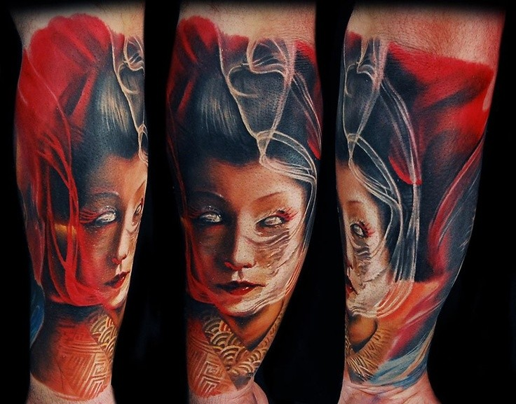 Cool looking colored forearm tattoo of very detailed monster geisha