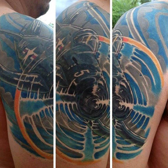 Cool looking colored illustrative style shoulder tattoo of WW2 fighter plane