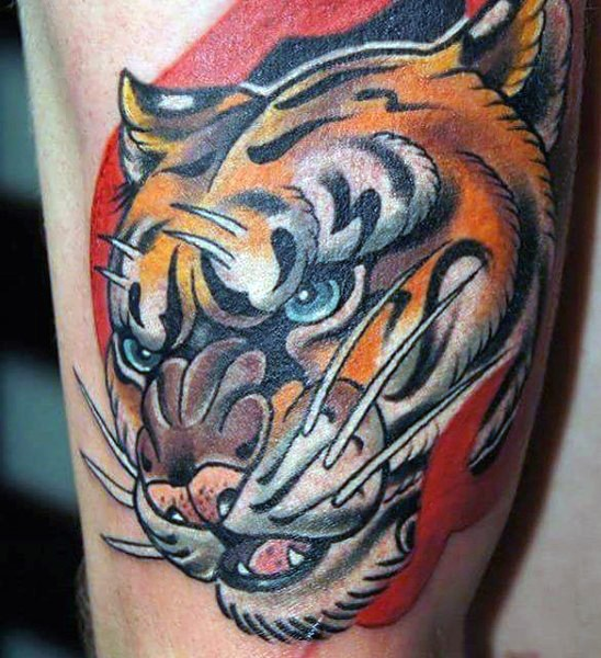 Cool looking colored leg tattoo of tiger head