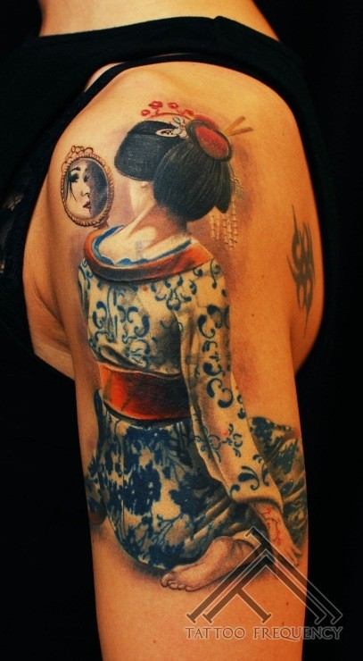 Cool looking colored shoulder tattoo of geisha woman with mirror