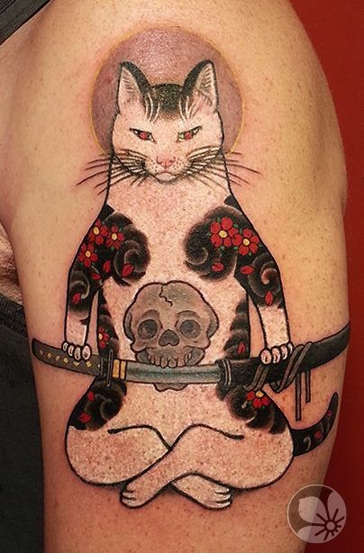 Cool looking colored shoulder tattoo of Manmon cat with katana sword by horitomo