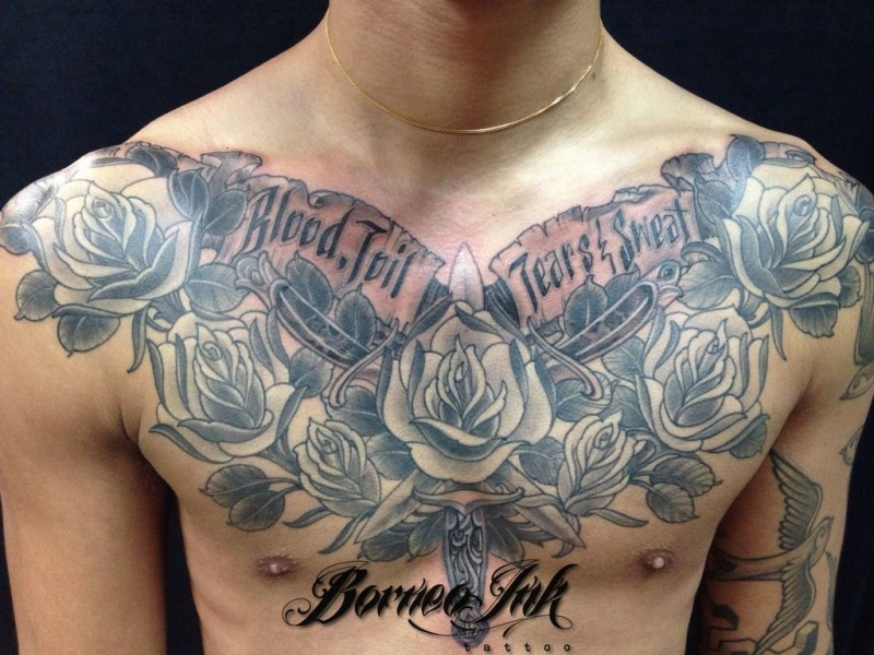 Cool looking gray washed style chest tattoo of rose flower with lettering