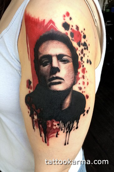 Cool new school style shoulder tattoo of man face
