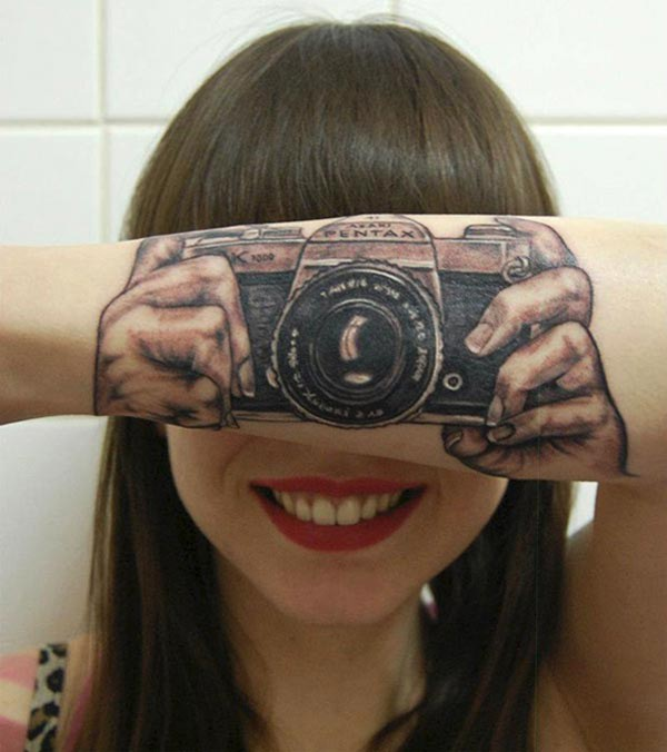 Cool old school colored camera tattoo on arm