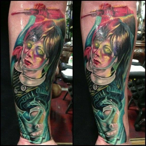 Cool painted and colored crazy girl maniac tattoo on arm