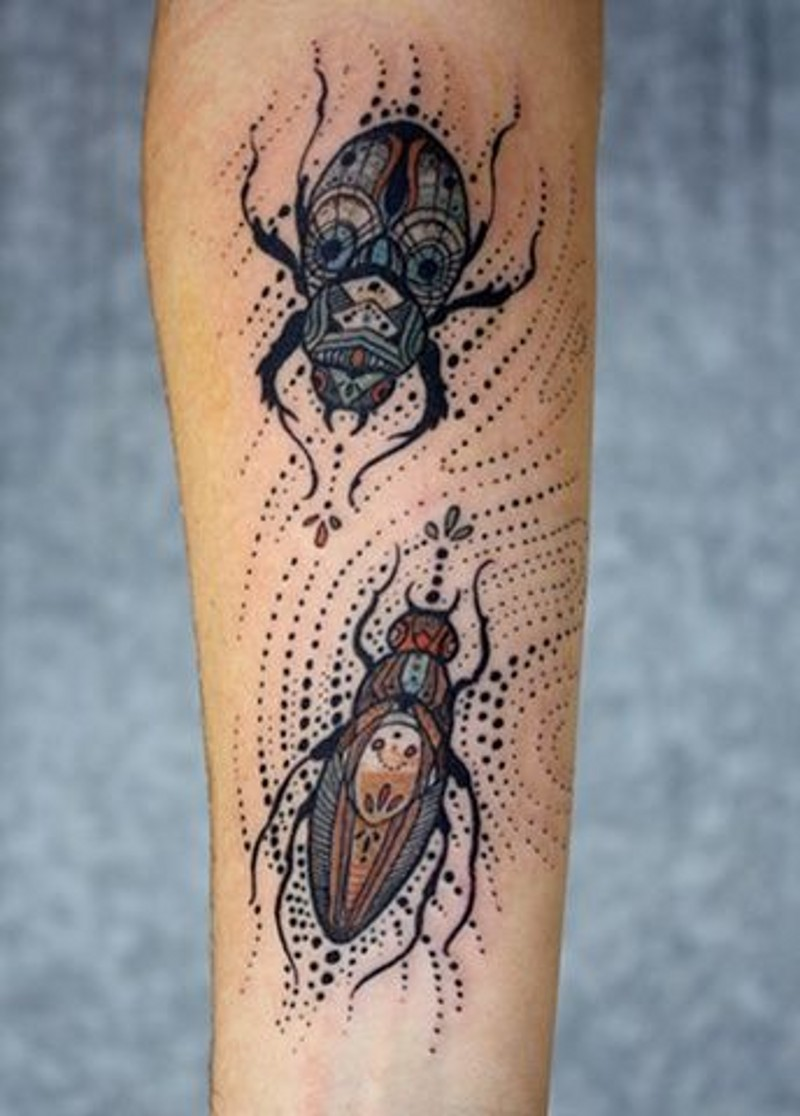 Cool painted and colored little bugs tattoo on arm