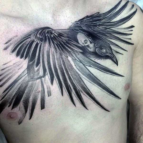 Cool painted black and white flying crow with skull tattoo on chest