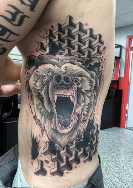 Cool painted black and white roaring bear tattoo on side with ornaments