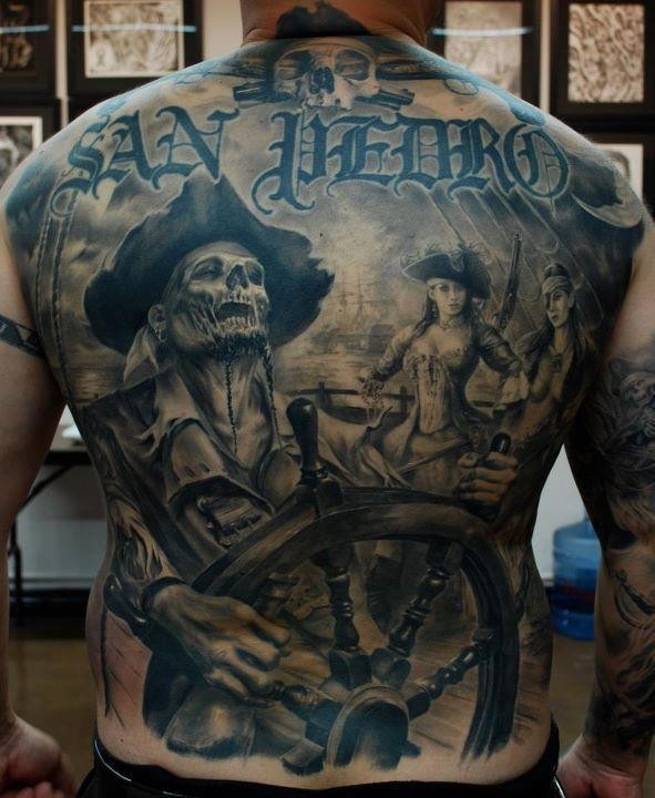 Cool pirate skeleton at the helm tattoo on back