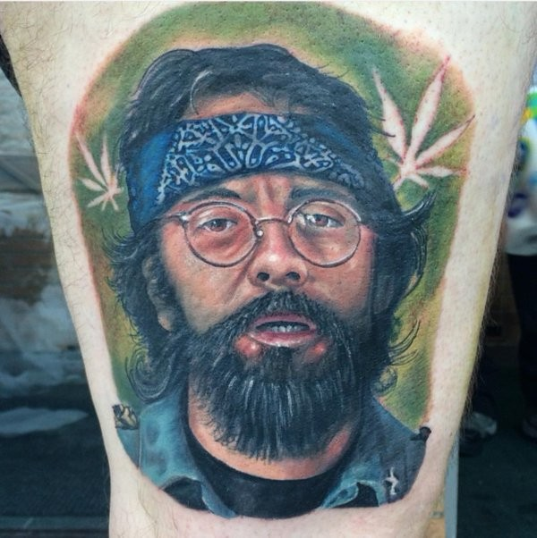Cool portrait style colored thigh tattoo of man with beard and glasses
