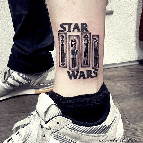 Cool sharp designed black ink various Jedi lightsabers tattoo on ankle stylized with lettering