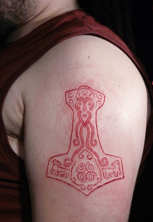 Cool skin scarification on shoulder for men for Skin gallery tattoo