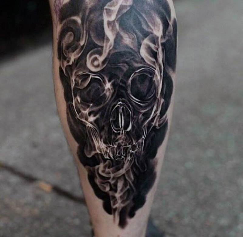 Cool stylized with smoke black and white skull tattoo on leg