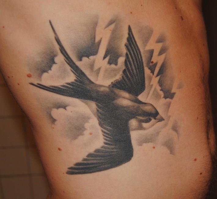Cool swallow bird tattoo flying in sky