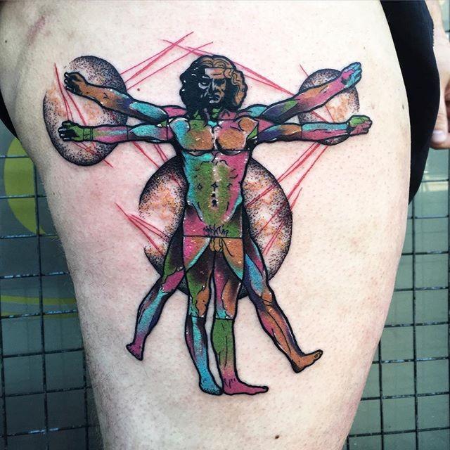Cool tattoo idea of Vitruvian man on thigh