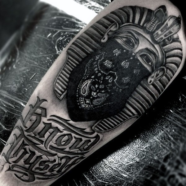 Cool thug style black ink arm tattoo of Egypt statue with lettering