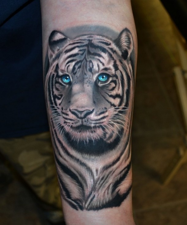 Cool tiger face tattoo with blue eyes