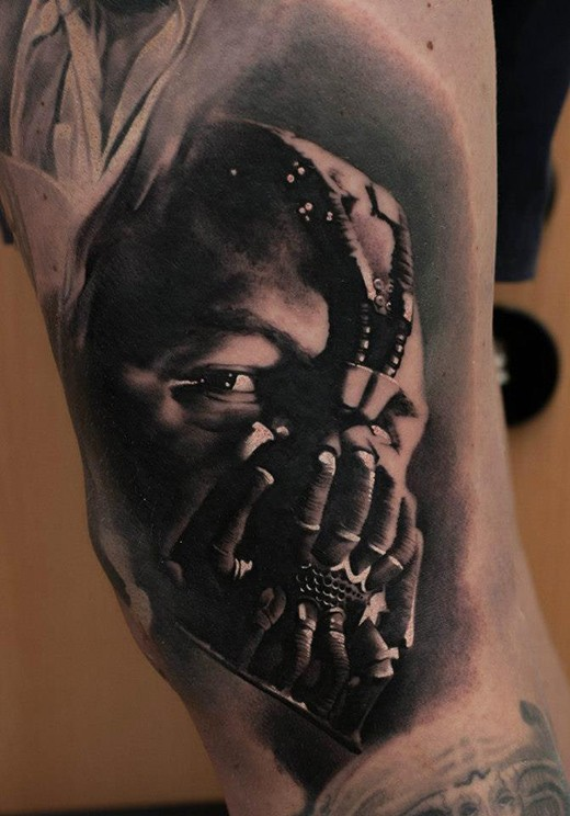 Cool very detailed black colored arm tattoo of Bane portrait