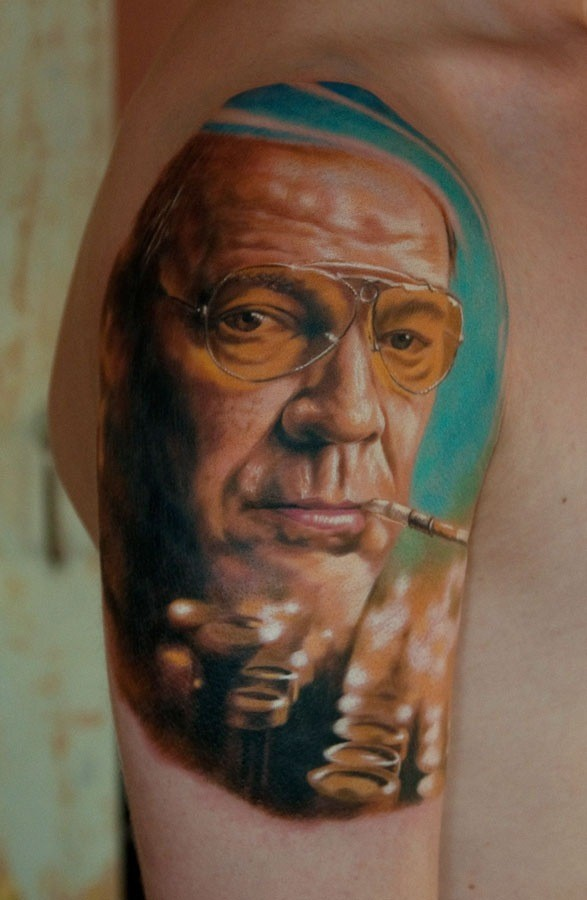 Cool very detailed shoulder tattoo of smoking man portrait