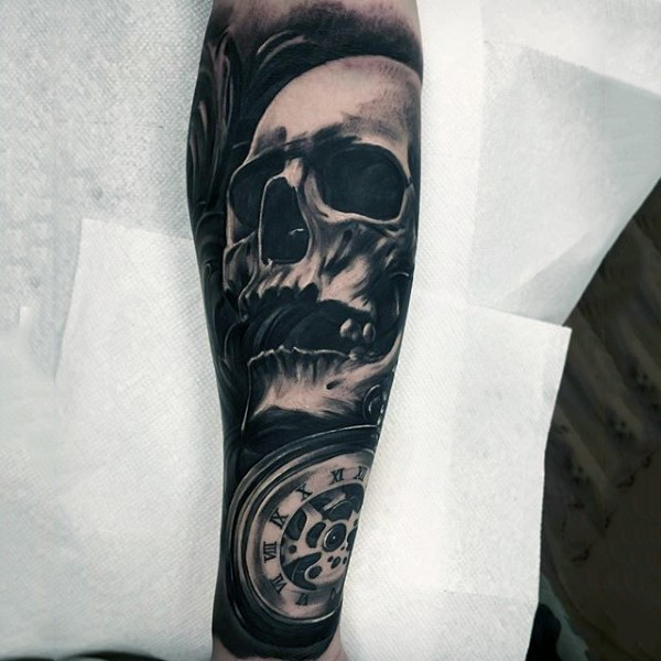 Cool vintage style black ink skull tattoo on forearm with old mechanic clock