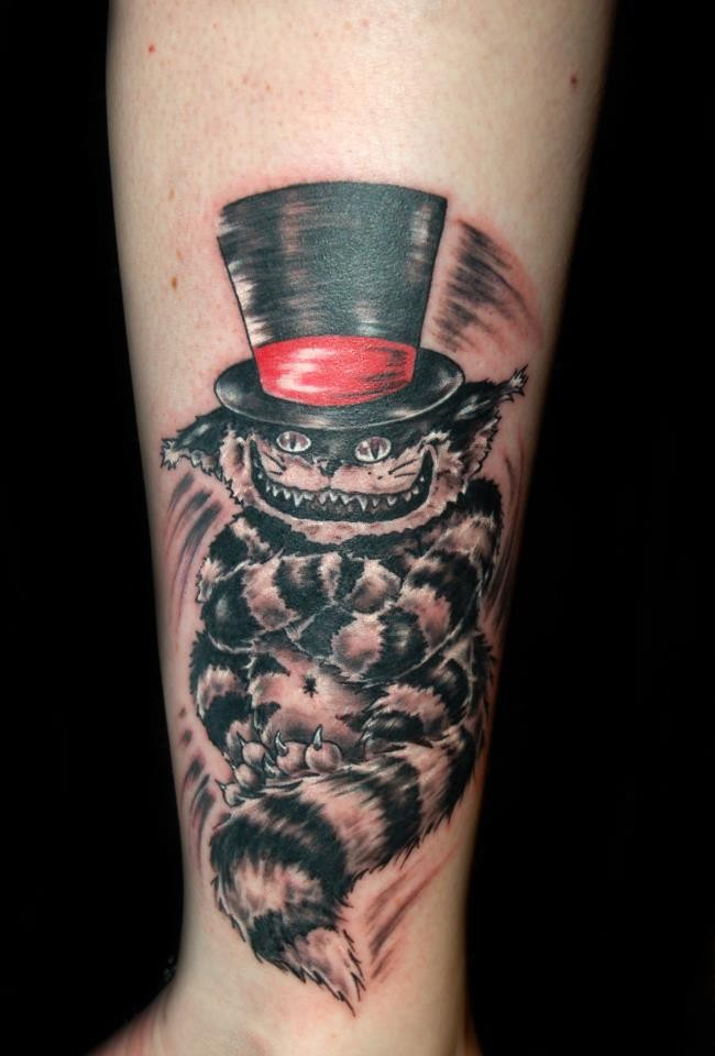Crazy cheshire cat forearm tattoo