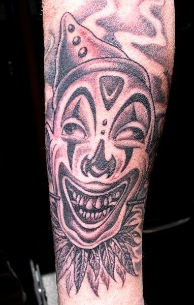 Crazy clown in a cap tattoo
