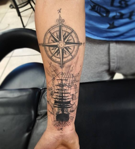 Creative black ink forearm tattoo of sailing ship with compass