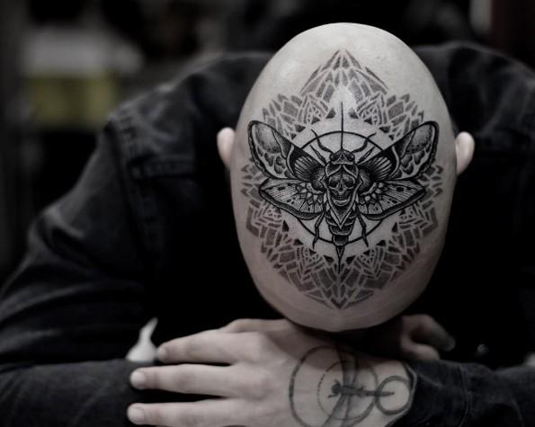 Creative blackwork style head tattoo of big fly