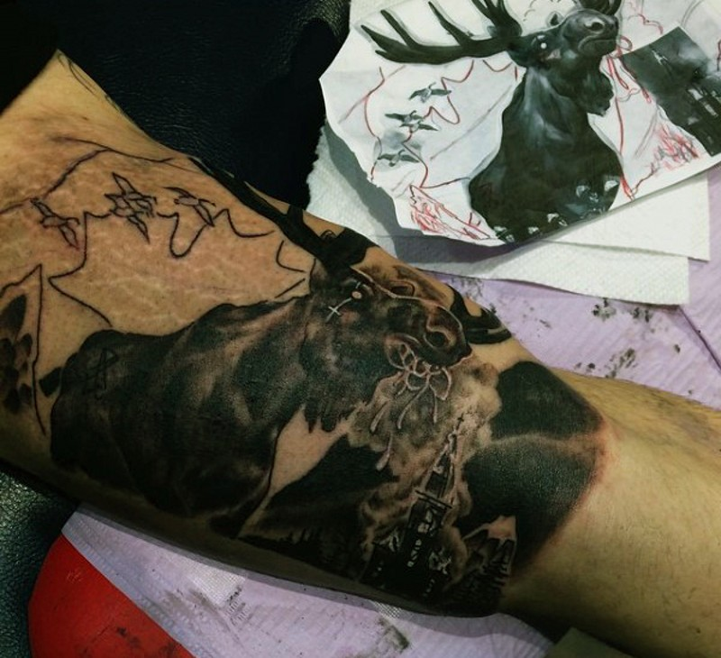 Creepy black and white mystical elk tattoo on biceps with dark cathedral