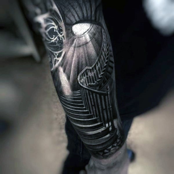 creepy black and white old house stairs tattoo on arm