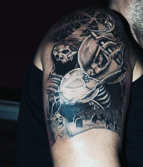 Creepy black ink terrifying witch with orb tattoo on shoulder with cemetery