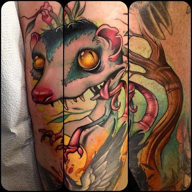 Creepy cartoon style colored funny rat tattoo