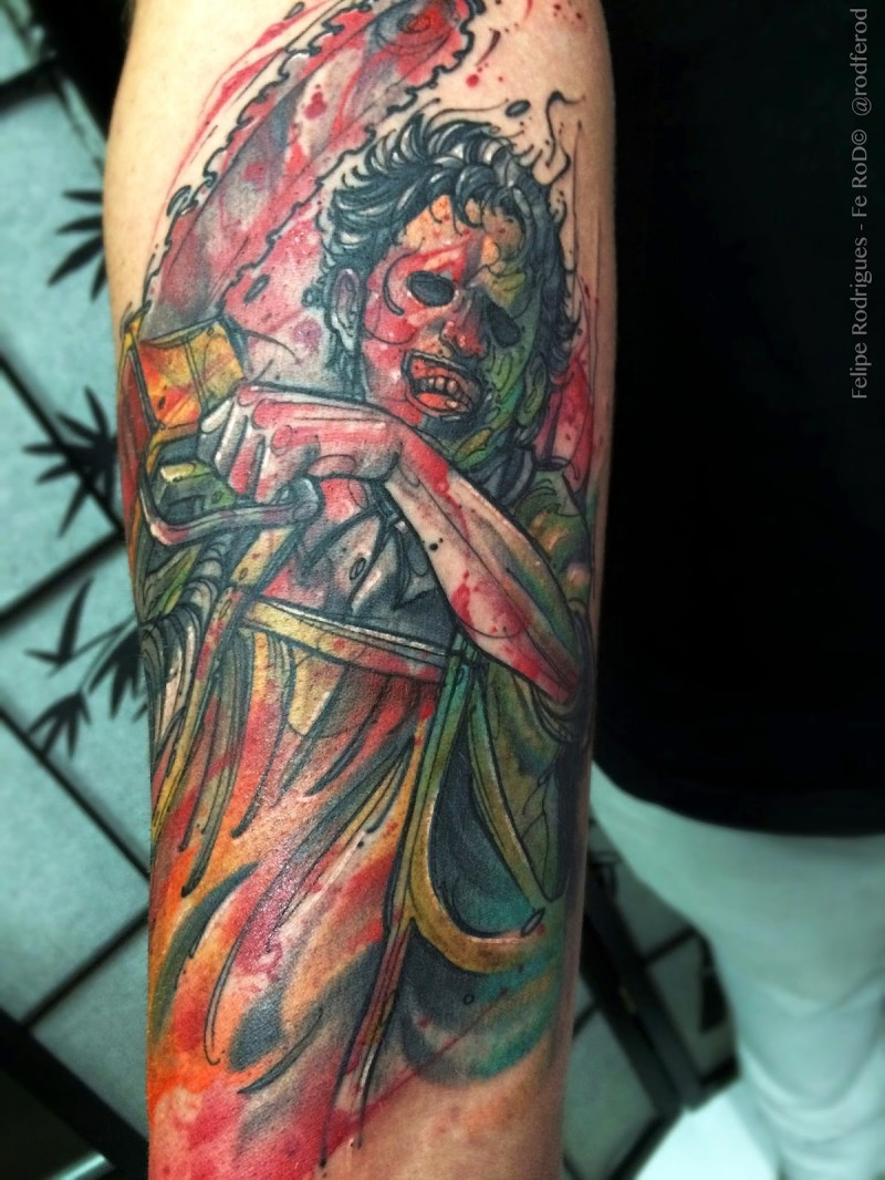 Creepy colored horror style arm tattoo of bloody maniac with chainsaw