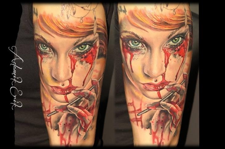 Creepy colored horror style forearm tattoo of bloody woman portrait