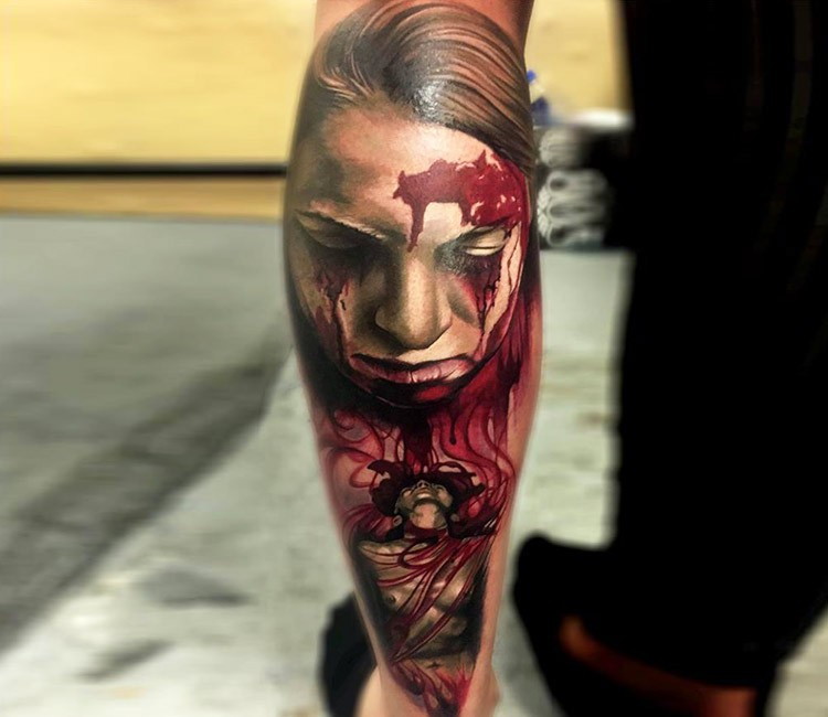 Creepy colored horror style leg tattoo of bloody woman portrait